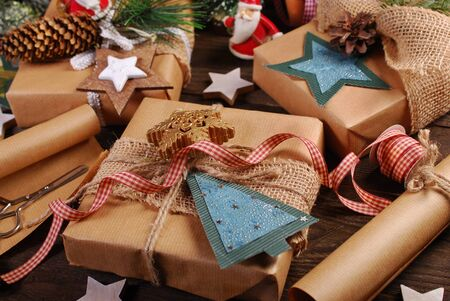 packing Christmas gifts in rustic style with handmade decors