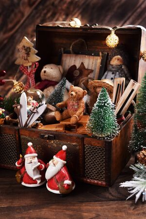 vintage style Christmas decoration with old toys and decors in wooden treasure chest