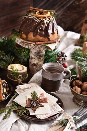 rustic style wooden table with Christmas Eve wafer, traditional cakes and decors