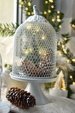 Christmas window decoration with metal net dome in vintage style