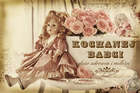 vintage style greeting card with bunch of pink roses and old doll with polish text Dear Grandma a lot of health and love