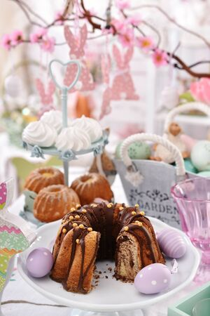beautiful festive table with traditional easter cakes and spring decors