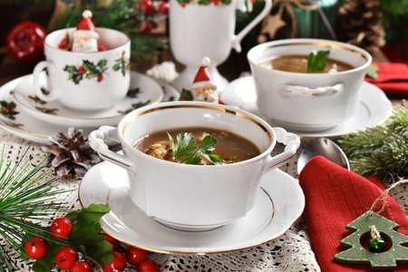 traditional Christmas Eve mushroom soup with barley on festive table