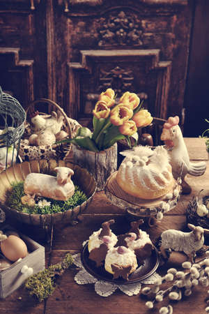 Rustic style Easter table with traditional pastries, decors and flowers