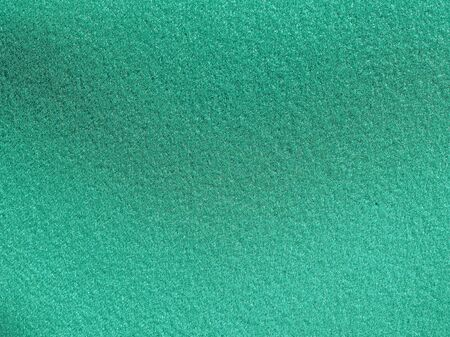 background color: Green artificial synthetic grass meadow texture useful as a background Stock Photo