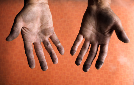 dirty car: Mechanic with dirty hands after fixing a car Stock Photo
