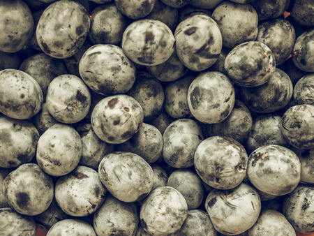 ciruela pasa: Vintage faded Prune fruits, vegetarian food useful as a background
