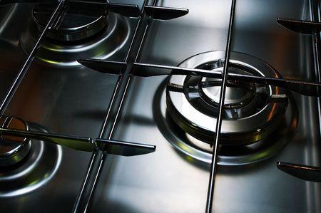 Metal gas cooker on modern kitchen Stock Photo