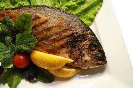 Grill a fish with salad on a dish Stock Photo - 666491