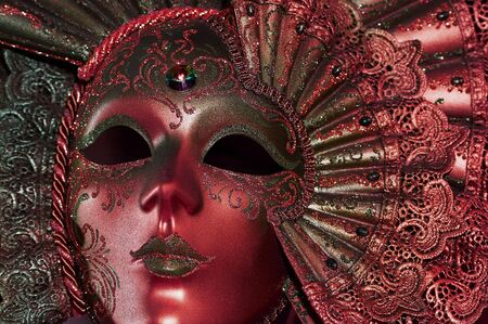 phantasy: Celebratory dark red mask with a jewel Stock Photo