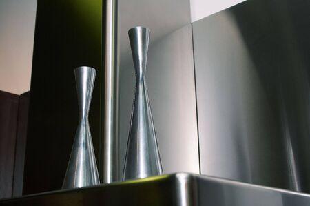 lustre: Metal flower vases on a metal background