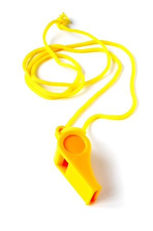 adjudicate: Yellow football whistle on a white background