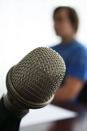 reviewer: Microphone in the foreground in radio studio