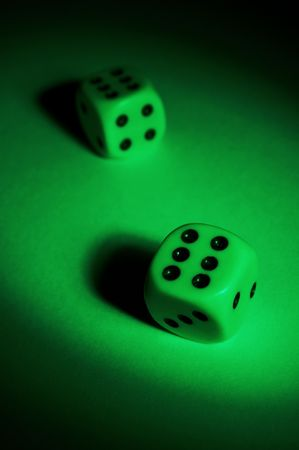 fervour: To play dice on a green table Stock Photo