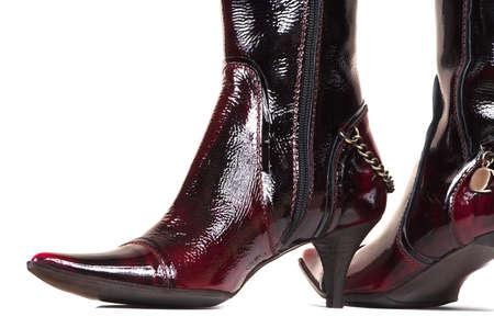 Female varnish boots on a white background photo