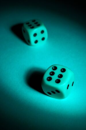 To play dice in a ray of light photo