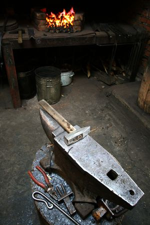 ancient blacksmith: Hammer and anvil in an old smithy