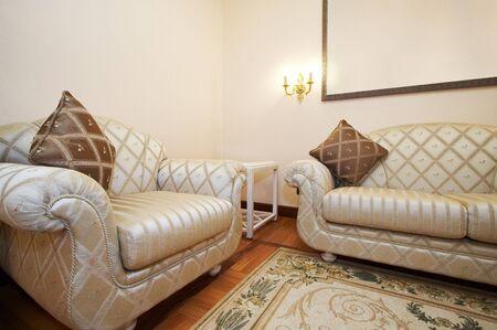 Beautiful armchair and sofa in modern hotel photo