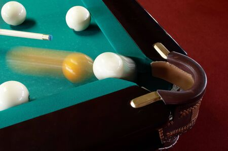 The sphere which slides in a billiard pocket photo