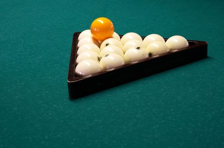 Billiard spheres in a triangle on a table photo