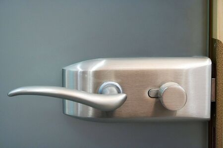 The metal door handle and the lock on a glass door Stock Photo - 759294