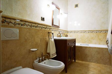 Bathroom in old style in modern hotel photo