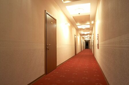 Corridor with a red carpet in hotel photo