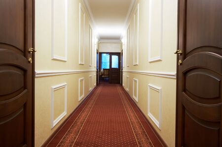 Long corridor with a window in modern hotel photo