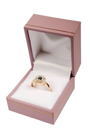 Precious ring in a pink box on a white background photo