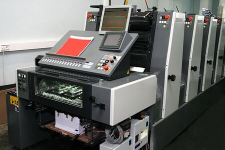 printing out: The new polygraphic machine in a modern printing house Stock Photo