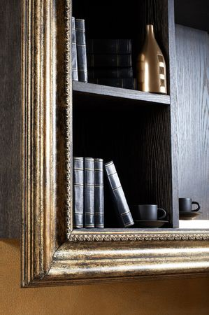 mantelpiece: Magnificent shelf with books, cups and a bottle Stock Photo