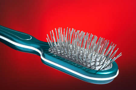 Hairbrush for hair on a dark red background photo