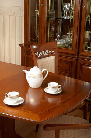 Two cups and  teapot on a table photo