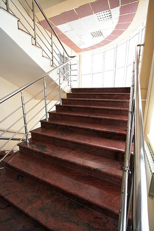 business life line: Marble staircase with a steel handrail in a modern building Stock Photo