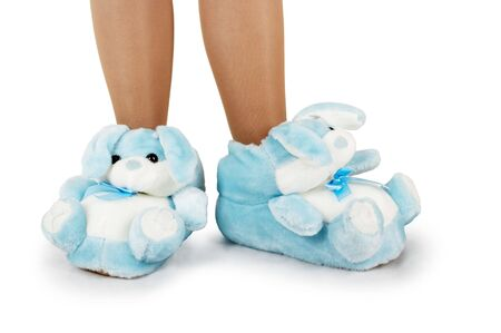 Blue house slippers on a white background photo