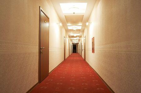 Beautiful and long corridor in modern hotel photo