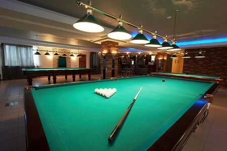 pool halls: Table for game in billiards in modern hotel Stock Photo