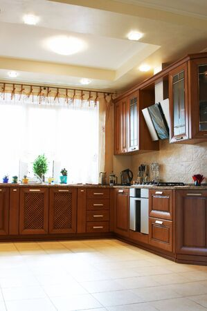 Wooden kitchen furniture in the modern house photo