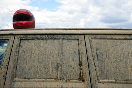 Protective helmet on a roof of the sports car Stock Photo - 915970