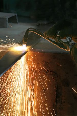 Gas welding of metal at a modern factory photo