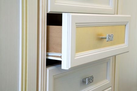 Modern white cabinet with drawers and handles Stock Photo - 1106049