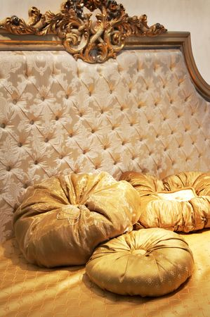 Three beautiful pillows on a rich bed photo