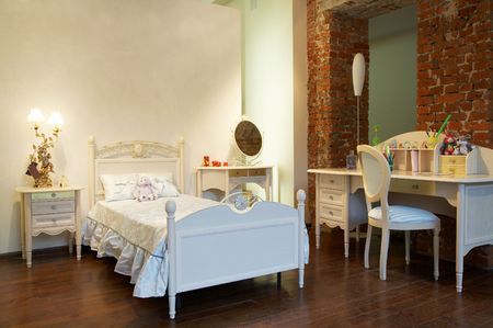Childrens bed and table in a modern bedroom