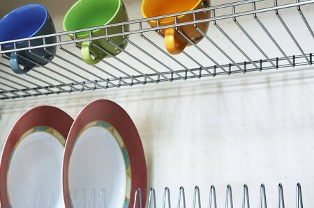 Plates and cups in a case on modern kitchen photo