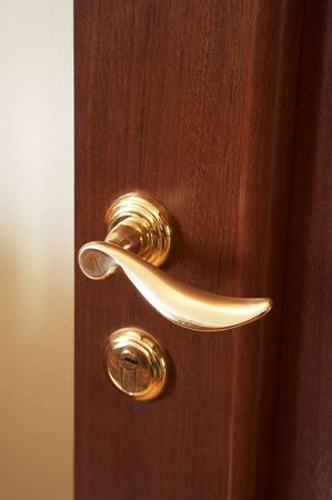 keystone light: Wooden door with the new brilliant lock Stock Photo