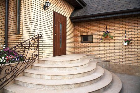Main entrance in a modern brick cottage Stock Photo - 1328914