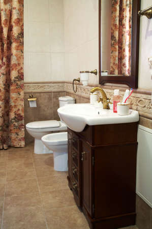 Toilet bowl, bidet and sink in a modern bathroom Stock Photo - 1335287
