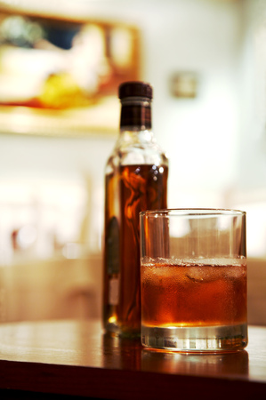 Glass of whisky with an ice on a table at restaurant Stock Photo - 1406846