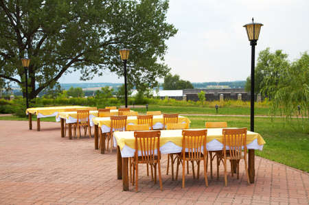Tables and chairs in cafe on fresh air Stock Photo - 1424354