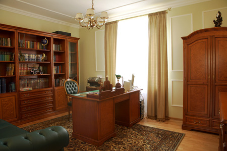 living wisdom: Bookcase, table and chair in a cabinet Stock Photo